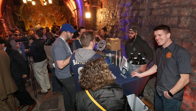 People gather in the Historic Miller Caves to sample craft beer that will be sold at Miller Park this summer. The Brewers announced an opening-day lineup including craft beers from 17 Wisconsin breweries.