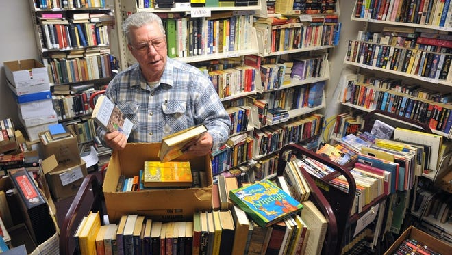 Alan Martin, president of the Friends of the Wichita Falls Public Library, sorts through books in this file photograph. Martin said the volunteer nonprofit group has until the end of June to move out of its warehouse space on Seventh and Austin and is hoping to reduce the Friends' inventory of 104,000 books, videos, magazines and more before the move. He said the organization does not have a storage facility and does not know yet where it might move to.