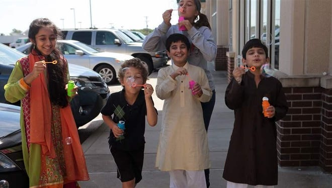 """Children celebrate the Muslim holiday of Eid al-Fitr in Joplin, Missouri. Some Americans of Middle Eastern and North African descent are lobbying the U.S. Census to create a separate """"MENA"""" category for the 2020 decennial count."""