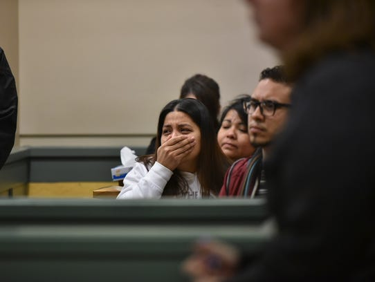 A woman cries Thursday during the arraignment for Ricardo