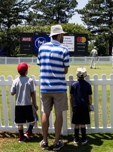 June 04, 2018 - People watch as golfers use the practice green during MondayÕs Danny Thomas Pro Am at the 2018ÊFedEx St. Jude Classic at TPC Southwind. The 2018 FedEx St. Jude Classic features a 156-golfer field full of past champions and the game's rising stars and runs through Sunday.