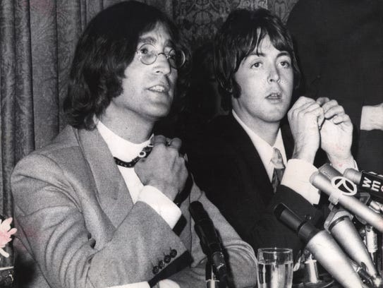 John Lennon, left, and Paul McCartney flew to New York