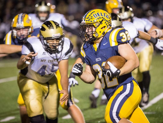 Delta's Charlie Spegal makes the run past Mt. Vernon's