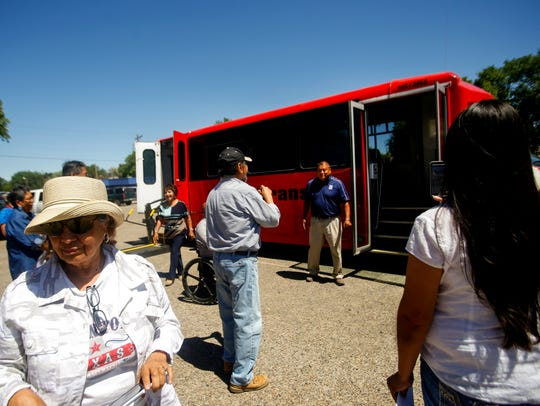 Community members inspect the Navajo Transit System bus Monday during an opening ceremony at the Shiprock Chapter house.