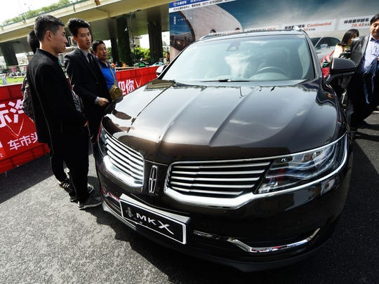 Customers looking at Lincoln cars at a showroom in Hangzhou in China's eastern Zhejiang province in April 2018.