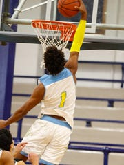 Jaemyn Brakefield flys over his defenders for Huntington Prep.