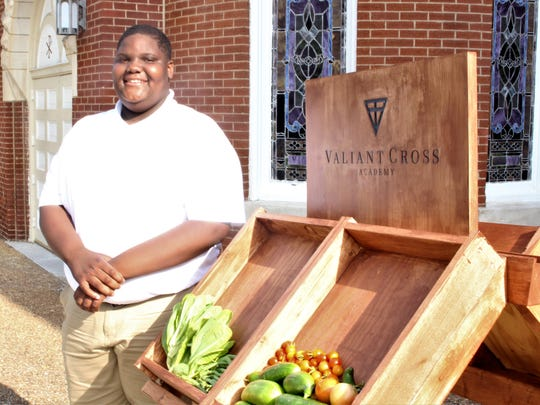 Bryant McMeans, 13, helped plant a community garden the past two years through a project between her school, Valiant Cross Academy, and Troy University, geared toward teaching the young men gardening techniques and entrepreneurial skills.