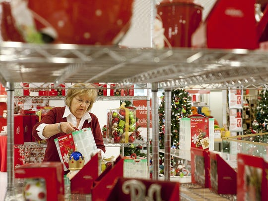 Belk part-time employee Marcella Armes rearranges Christmas