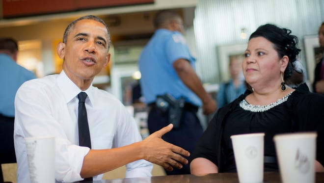 President Obama sits down for lunch with Shelby Ramirez at a Chipotle Mexican Grill in Washington June 23, 2014, before they attend the White House Summit on Working Families.