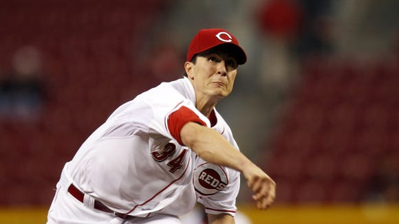 Reds starting pitcher Homer Bailey pitches to the Pirates in the first inning at Great American Ball Park Monday.