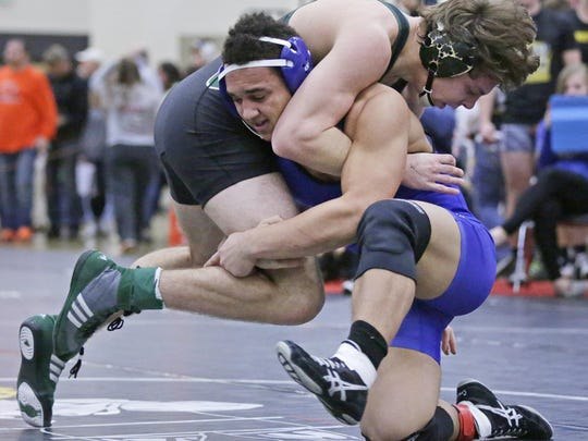 Wrightstown's Bryce Herlache, bottom, is one of four