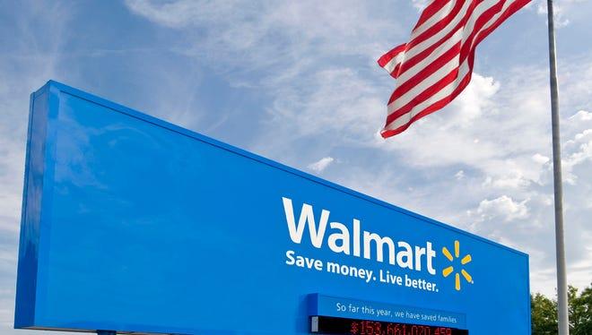 Wal-Mart says it'll introduce a checking account service through Green Dot.