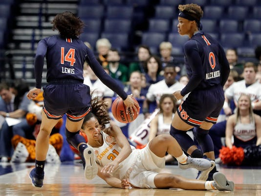 Tennessee guard/forward Jaime Nared (31) falls as she chases down the ball with Auburn's Tiffany Lewis (14) and Daisa Alexander (0) in the first half of an NCAA college basketball game at the women's Southeastern Conference tournament Thursday, March 1, 2018, in Nashville, Tenn. (AP Photo/Mark Humphrey)