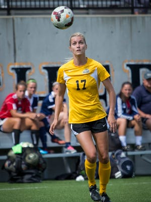 Aubrey Muench, a Newport Central Catholic graduate, goes to the ball in NKU's 2-1 overtime victory over Robert Morris Sept. 14.