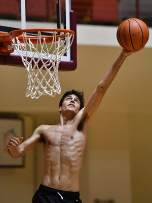 Jake Merrell practices Wednesday at Midwestern State University for the All-Star Basketball game in conjunction with the Texas Six-Man Coaches Association football games.