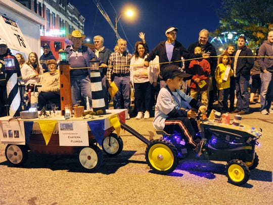 Alex Rawlinson, 5, drives his tractor pulling his float with three of his favorite lighthouses from Florida, down Franklin Street in the Lighthouse Parade at the West Side Nut Club Fall Festival in 2013.