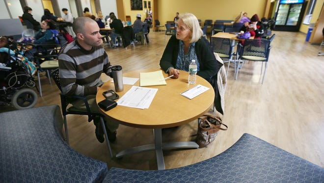 Terrie Meyn, COO Rochester Rehab, CP Rochester and Happiness House, right, holds an informal meeting with Bryan Rogers, supervisor of DriveOn, in the newly renovated cafe on the first floor at the Al Sigl Community of Agencies Tuesday, Nov. 24, 2015 in Rochester.  The cafe is meant to be a more inclusive and relaxed area for all to use at the campus.