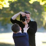 Former fashion photographer Rick Guidotti shoots Austin Bitter, 9, of Symmes Twp. Austin has Fragile X Syndrome, one of the known genetic conditions to cause autism.