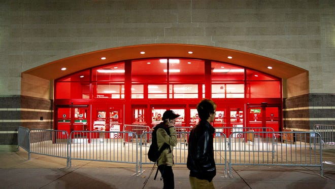 Two young men walk past the front door at a Target store in this November 24, 2011 file photo in Fairfax, Virginia.