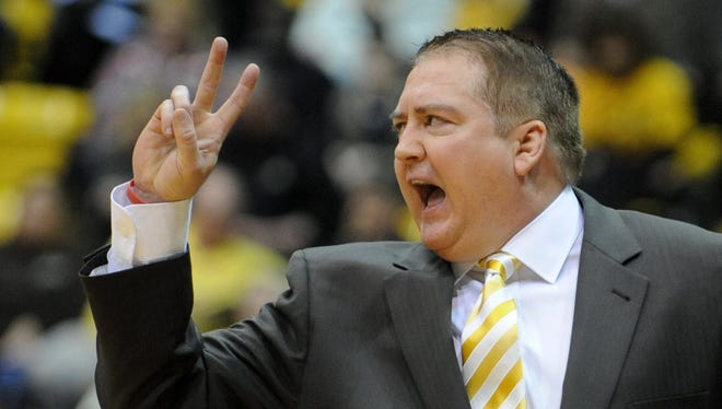 Former Southern Miss head coach Donnie Tyndall calls to his players as they take on Rice.