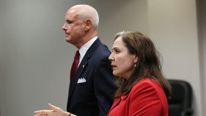 Maggie Cassaro, right, testified in a trial to settle a dispute over damages she suffered to her vehicle after hitting and killing Ken Herrington's, left, dog in an accident.Nov. 3, 2016