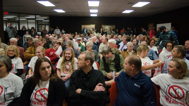 More than 200 people attended a public hearing on a change to the wind farm ordiances for Wayne County held by the Advisory Plan Commission, Monday, Dec. 5, 2016 at the county annex building in Richmond, Ind.