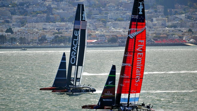 TOPSHOTS Seen from Alcatraz Island, Oracle Team USA (L) and Emirates Team New Zealand (R) fight for a controlling position during the tenth race of the 34th America's Cup on September 15 in San Francisco.