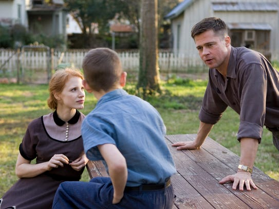 Jessica Chastain and Brad Pitt (right) in 'The Tree