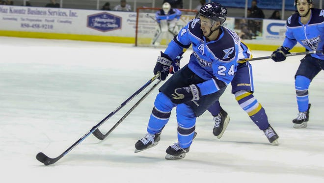 Pensacola's Roger Tagoona (24) skates into the Roanoke Rail Yard Dawgs' zone Sunday afternoon at the Pensacola Bay Center.