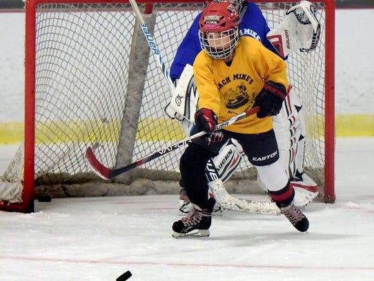 """Averi Reider, 10, of Red Lion, skates for the puck"