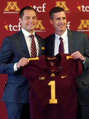 Minnesota athletic director Mark Coyle, right, introduces P.J. Fleck as the new head football coach Jan. 6, 2017, in Minneapolis.