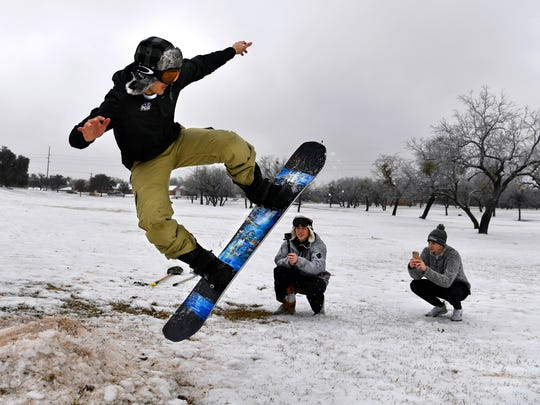 Jake Gandy takes flight Thursday thanks to the slight jump he made with Josh Hargett (center) and Coby Bryant. All three are Abilene Christian University students studying business management, they joined others at the Wildcat Disc Golf Course for a little winter fun while it lasted.