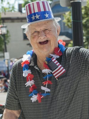 Eighty-three years young, Robert Flinn, a resident of Senior Living of Northville, is all smiles at the parade.