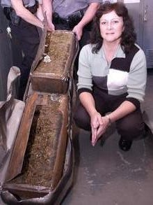 Mary Fanara, who was Bunkie police chief at the time of this 2003 photo, is shown next to about $200,000 worth of marijuana that was discovered to have been hidden in a pickup truck. Fanara, who served as Bunkie police chief for 16 years before retiring last year, died Tuesday at the age of 58.