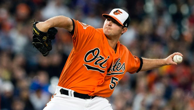 Orioles relief pitcher Zach Britton throws a pitch against the New York Yankees in the ninth inning at Oriole Park at Camden Yards.