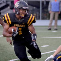 West Allis Central's Xavier Mullins ran for three touchdowns, along with teammate Glenn Martin, in the Bulldogs' 63-0 romp over Hope Christian on Aug. 26.