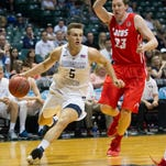 BYU guard Kyle Collinsworth gets past New Mexico  forward Joe Furstinger (23) to drive down the baseline at the Diamond Head Classic, Wednesday, Dec. 23, 2015, in Honolulu.