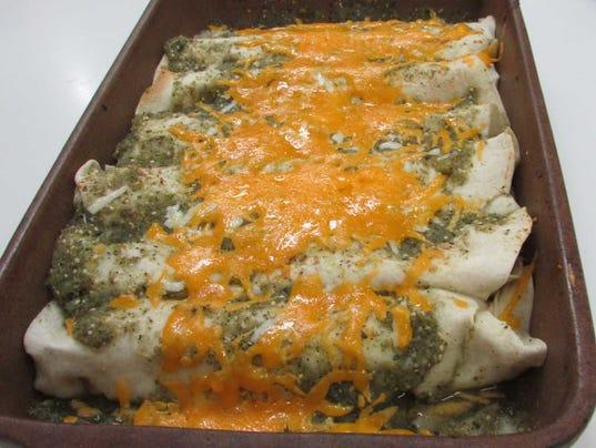 Pork Green Chili Enchiladas. (Photo: Sweet Basil Cooking School)
