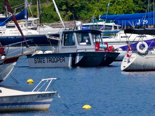 Members of the Vermont State Police join the search for missing boater Brian Webb on Malletts Bay in Colchester on Monday.