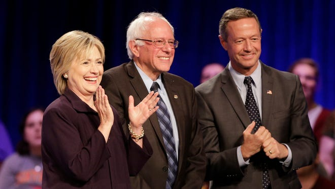 Democratic presidential candidates, Hillary Rodham Clinton, left, Sen. Bernie Sanders, I-Vt, center, and former Maryland Gov. Martin O'Malley, right, looks to the crowd after a democratic presidential candidate forum at Winthrop University in Rock Hill, S.C., Friday, Nov. 6, 2015.