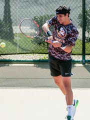 Dougaz is from Tunisia, where he first learned how to play tennis.