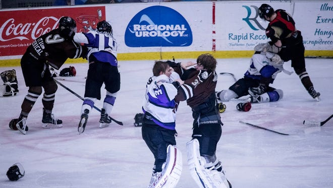 Mudbugs goalie Gustavs Grigals fights his counterpart from Kenai River during Saturday's game on George's Pond at Hirsch Coliseum.