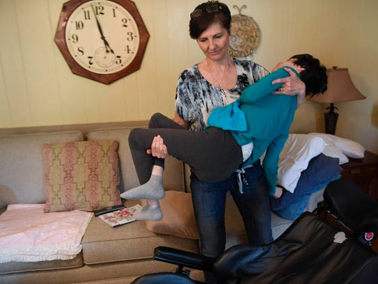 Kelli Campbell moves her daughter Samantha from her