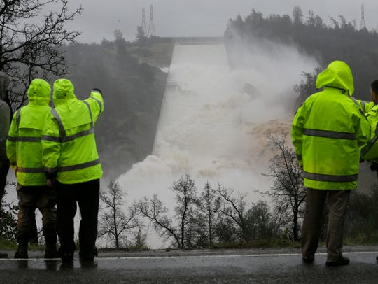 In this Feb. 9, 2017, file photo, water rushes down