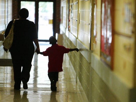 A parent and student walk through Myrtle Place Elementary