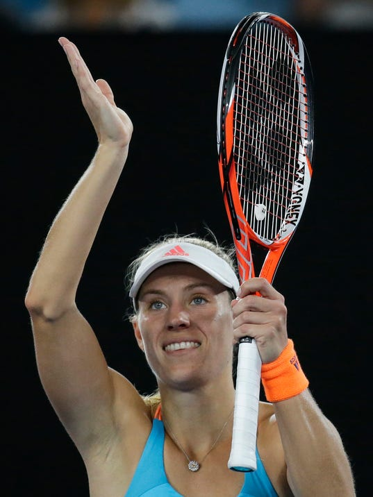 Germany's Angelique Kerber acknowledges to crowd after defeating Ukraine's Lesia Tsurenko during their first round match at the Australian Open tennis championships in Melbourne, Australia, Monday, Jan. 16, 2017. (AP Photo/Aaron Favila)