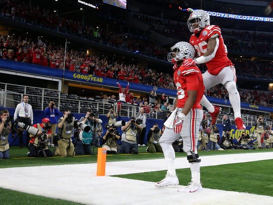 Ohio State quarterback J.T. Barrett celebrates one