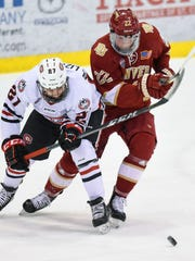 St. Cloud State's Blake Lizotte and Denver's Logan O'Connor struggle for control of the puck during the first period of the Saturday, Feb. 24, game at the Herb Brooks National Hockey Center in St. Cloud.