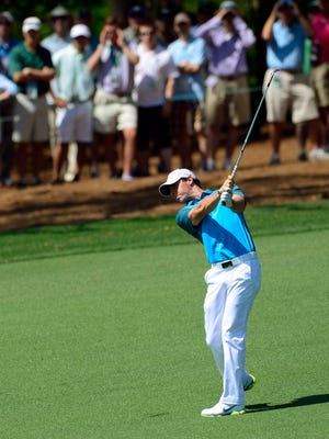 Rory McIlroy hits from the fairway of the ninth hole during the third round of the 2014 Masters golf tournament at Augusta National Golf Club.