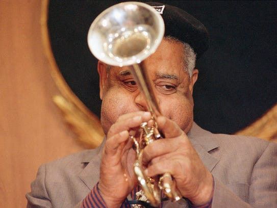 Jazz musician Dizzy Gillespie plays his King Silver